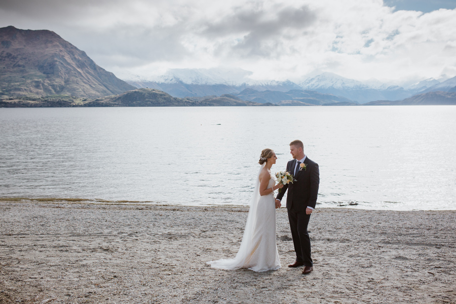 Melissa and Tyler enjoying the view as husband and wife after their Lake Wanaka Wedding Ceremony, with photography by Alpine Image Company