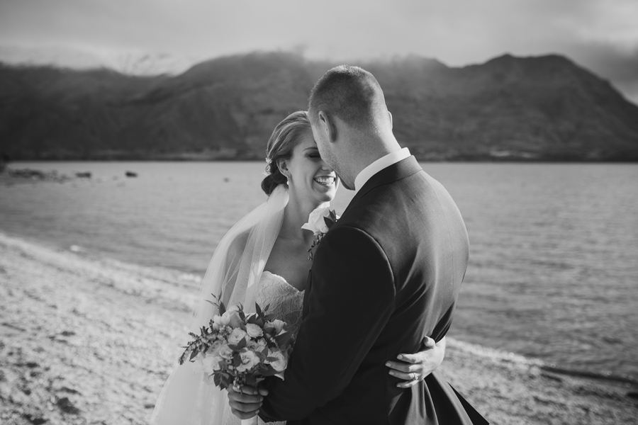 Melissa and Tyler enjoying a moment as husband and wife after their Lake Wanaka Wedding Ceremony, with photography by Alpine Image Company